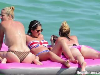 Image 1: Camera cachee voyeur qui filme des jeunes filles topless en bikini sur la plage